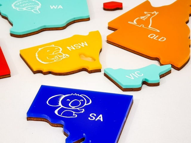 Laser Cut Puzzle pieces made from wood and coloured acrylic